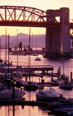 Boats under Burrard Bridge