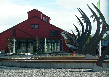 Historic Salt Building retrofitted and flanked by a pair of sparrow sculptures. May 2010.
