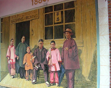 Mural depicting Wah Chong family outside their laundry business in Vancouver. By Arthur Cheng 2010. 1885 date