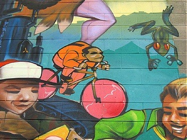 Bike imagery detail in outdoor art mural at Clarke and Powell St.,  Vancouver BC. The Earth Giveth, The Earth Taketh Away (2007). Photo by  John Steil