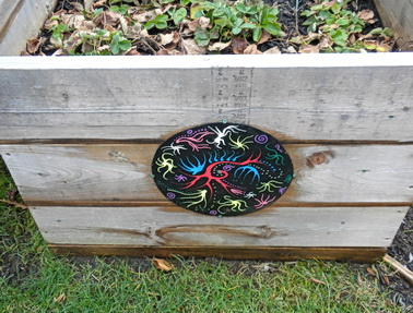 Mandala art with sea-life theme installed on sides of plant bed boxes for community gardens on city hall's front lawn. Vancouver, BC 2010. Photo by HJEH Becker