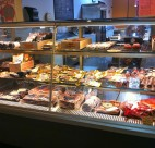 Imported meats at the Hastings St. location of les amis du FROMAGE