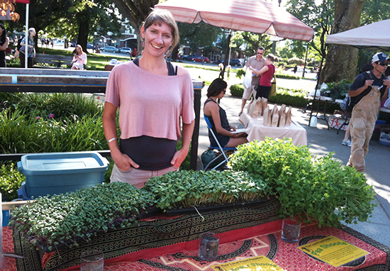 Lucy Brain from Food Pedallers poses with locally grown micro-greens Photo credit: Miranda Post