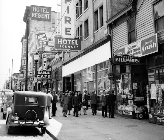 """East Hastings Street 1948: The State with its wall sign proclaiming the Sunday """"midnite show""""—actually, Monday morning. VPL Special Collections 80617."""
