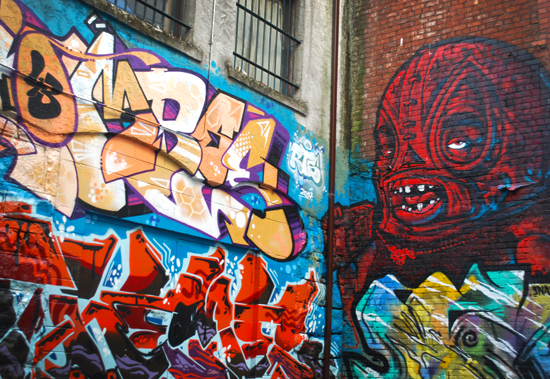On the left, a piece by Combo and on the right, a piece by Soak. Photo by Ehren Seeland