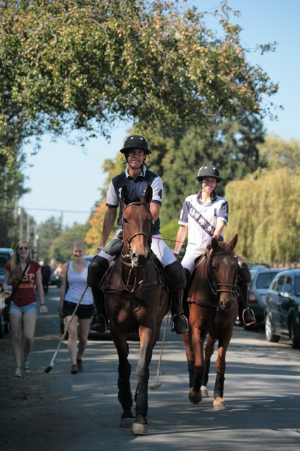 Horses share the road with cars, bikes, and pedestrians in Southlands. Photo by Noriko Tidball.