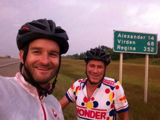 Ned Bell (left) takes a break from cycling for a selfie with TV personality Bob Blumer.