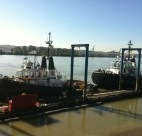 Tugboats docked in front of New Westminster