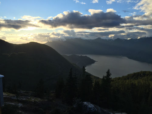 A winter sunset over Howe Sound from the Sea To Sky Gondola lodge deck. Photo credit: Carolyn Ali.