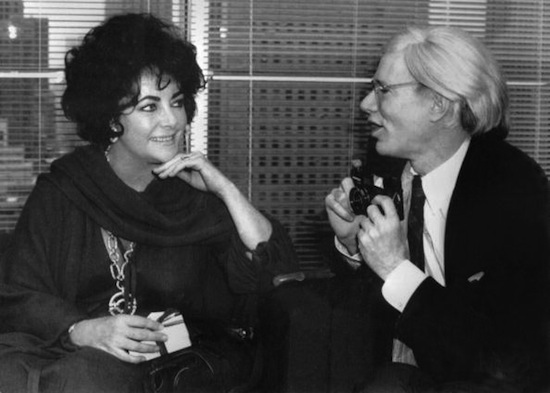Andy Warhol (R) asks Mrs John Warner (L)