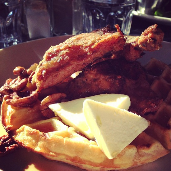 The traditional Two Chefs and a Table chicken and waffles. Photo Credit: Adrien G. | Yelp