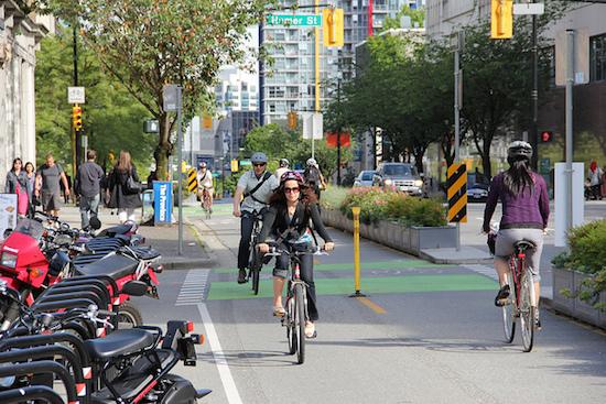 A cyclist along a downtown Vancouver bike lane. Photo credit: Paul Krueger   Flickr