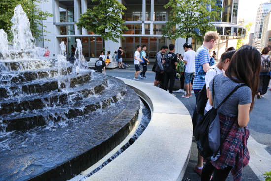 Pokémon Go players at the Waterfront Centre courtyard fountain.