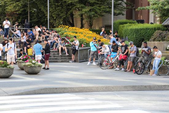 Pokémon Go devotees congregate across the street from Waterfront Centre between Pokémon Go Lure spots.