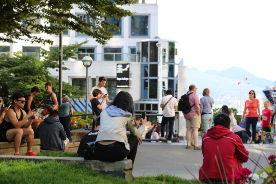 Pokemon Go fans gather between Pokemon Lure Stops at The Vancouver Club, the Jumping Jack art installation, and Waterfront Centre.