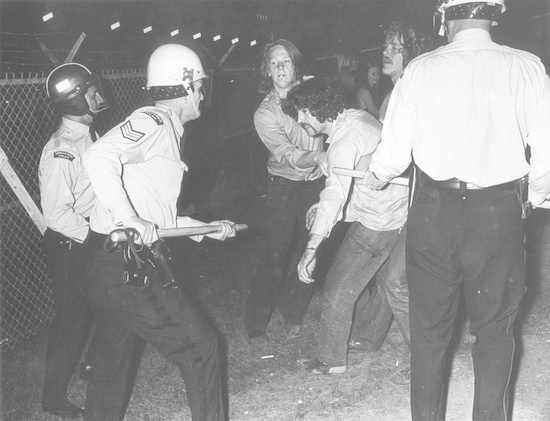 At the height of the chaos, the riot squad pushed the crowd back to Renfrew Street. June 3rd, 1972 PNG Library/Vancouver Sun