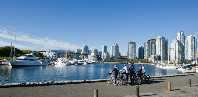 A group of cyclists on the False Creek Seawall in Vancouver.