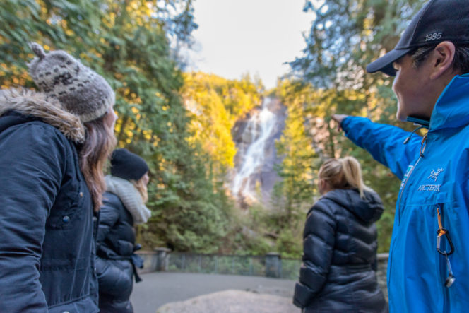 Tourists look at Shannon Falls in Squamish, BC