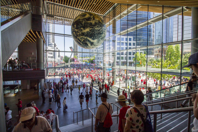 Entrance to Vancouver Convention Centre, glass walls, globe hanging from ceiliong.