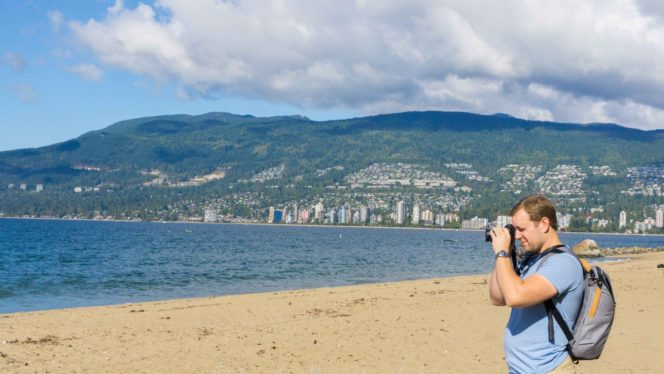 man taking photo Thurd beach Vancouver