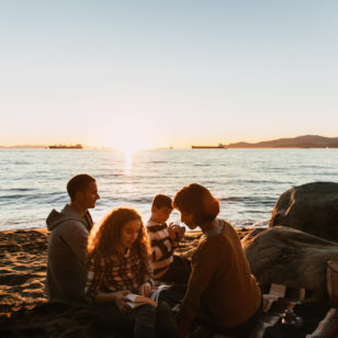A group having a picnic at Third Beach in Stanley Park in Vancouver, BC