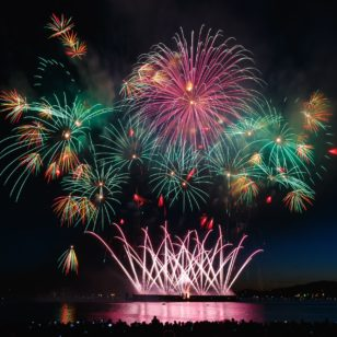 fireworks or red, green and yellow explode above vancouver