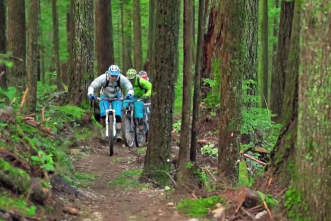 mountain bikers on a trail in North Vancouver, BC
