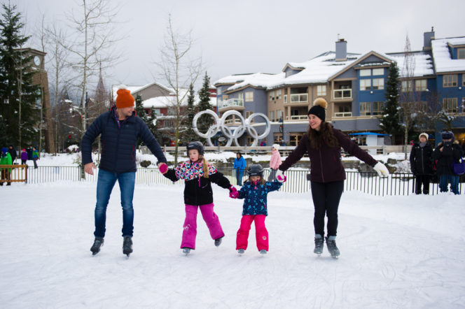 A family skating on an outdoor rink in Whistler