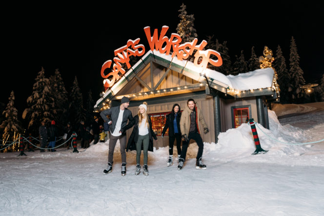 A group of ice skaters on a frozen pond at Grouse Mountain near Vancouver