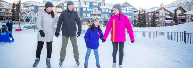 A family skating on the outdoor rink in Whistler BC