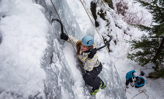 A woman ice climbing near Whistler