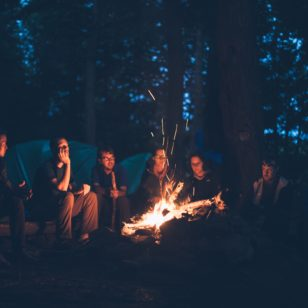 Group of people having a campfire