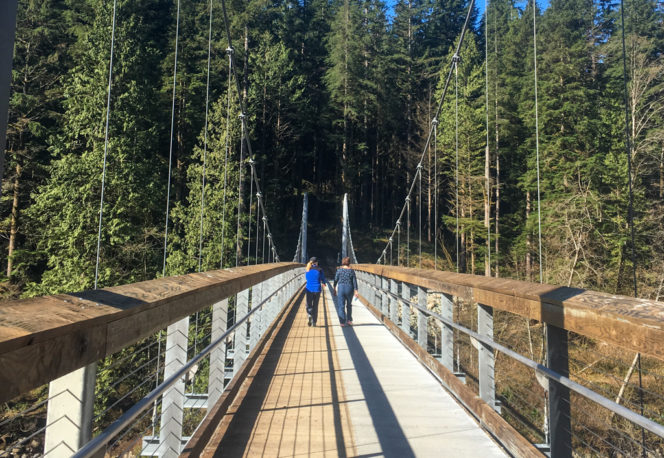 Walking across the new Twin Bridges suspension bridge in North Vancouver