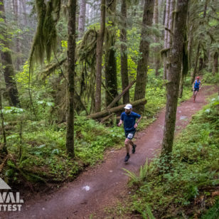 Runners on a forested trail in Squamish, BC during the Survival of the Fittest trail running race
