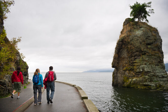 People walk on the seawall in Vancouver's Stanley Park