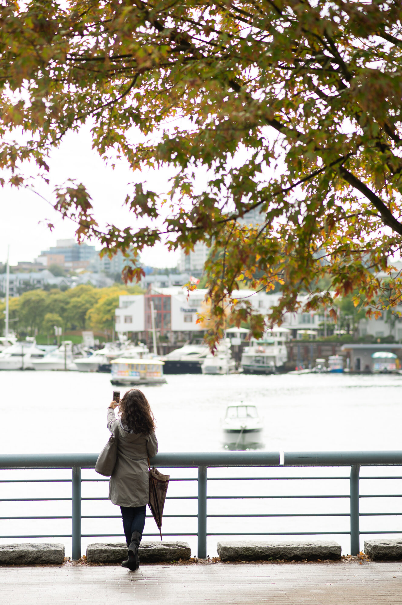 Woman taking photo during autumn in Vancouver