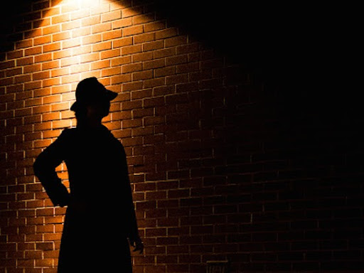 A silhouette ofa detective from Vancouver Mysteries