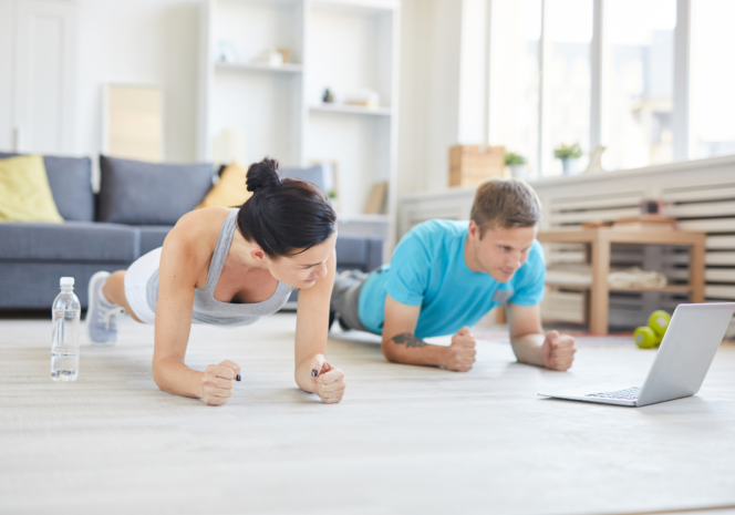 Couple working out at home. Workout at home online yoga classes in Vancouver