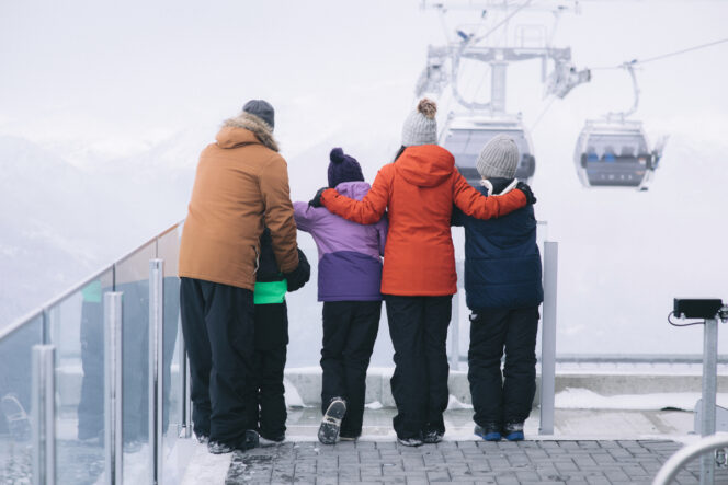 A family at the gondola platform at Whislter Mountain near Vancouve