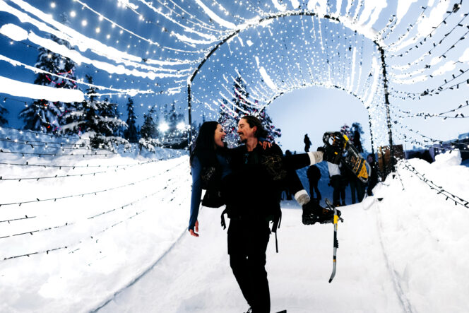 A couple walking through a tunnel of lights at Grouse Mountain in Vancouver