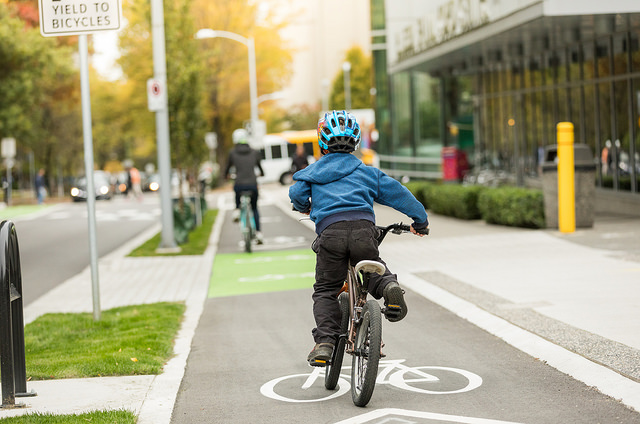 A child riding in a bike lane in Vancouver
