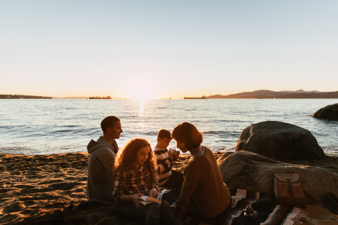 Family enjoying a picnic on the beach in Vancouver