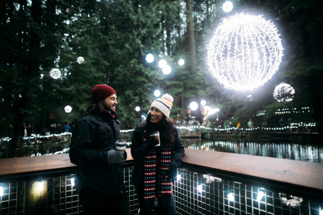 A couple enjoying twinkling lights at Capilano Suspension Bridge in Vancouver