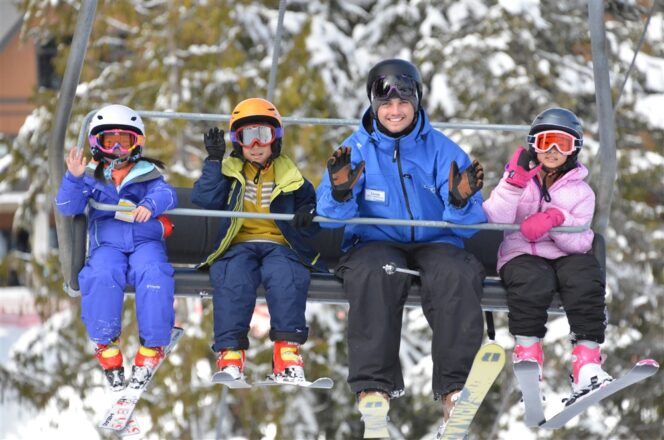 Kids ride the chairlift with their instructor during a ski lesson at Cypress Mountain in Vancouver