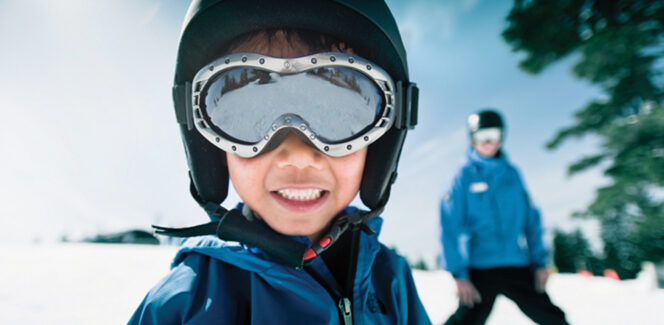 A close-up of a child enjoying a ski lesson at Grouse Mountain in Vancouver