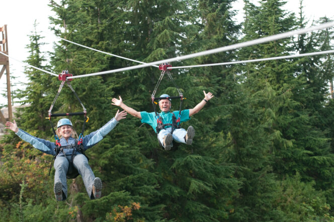 Two people ride the zipline at Grouse Mountain in Vancouver