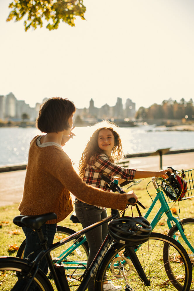 Family cycling on the Stanley Park Seawall in Vancouver