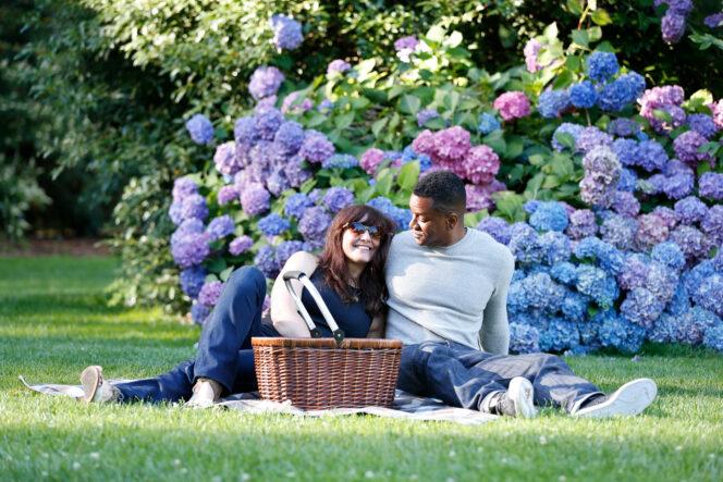 A couple picnicking in a garden