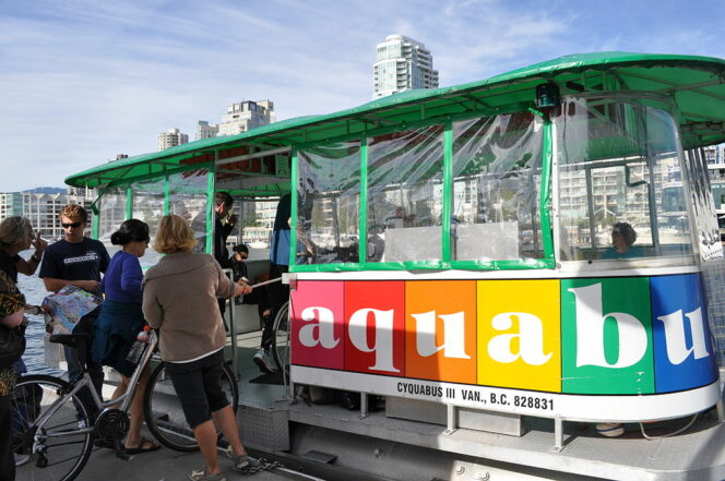 Cyclists loading bikes on to the Aquabus in Vancouver