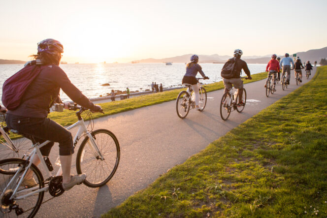 Cyclists on the Seawall at English Bay in Vancouver